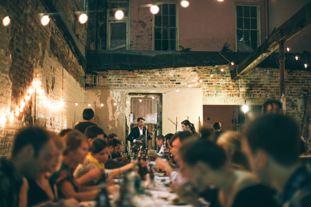 People eating at a pop-up dinner